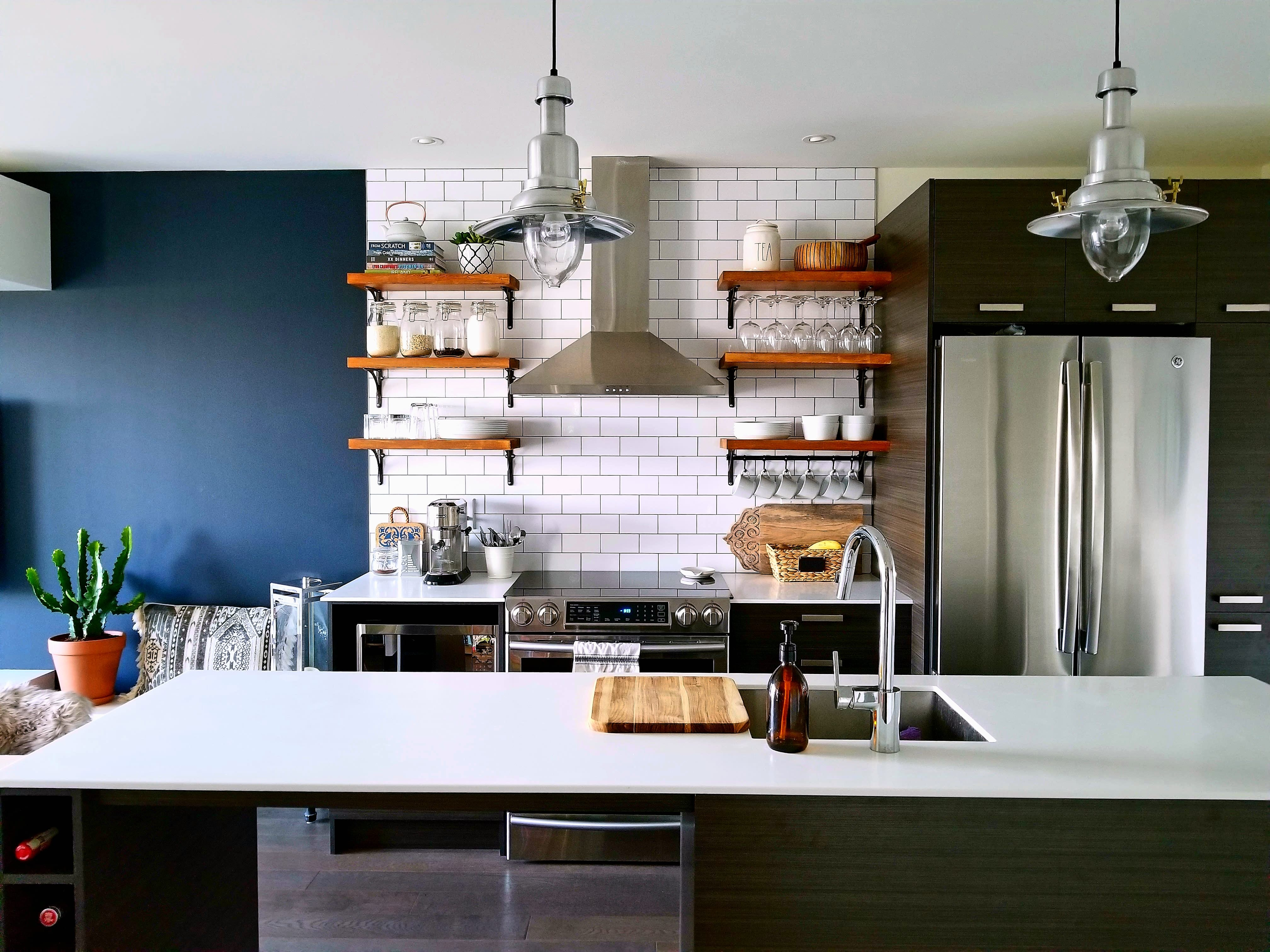 Open kitchen shelving on subway tiles