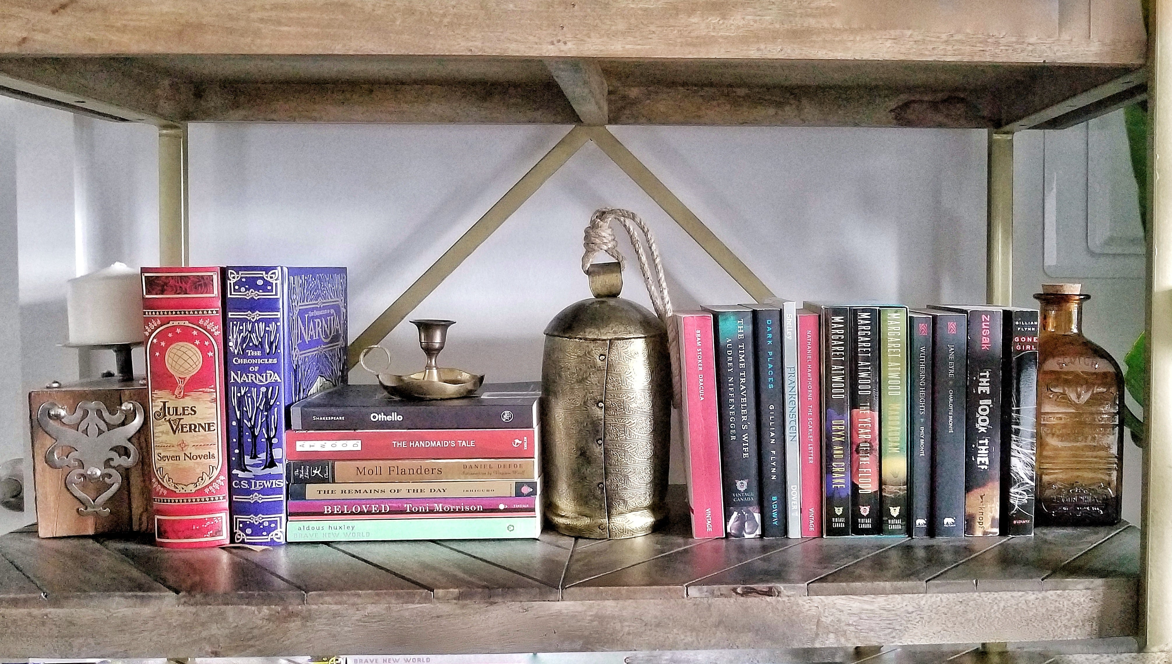 Bookshelf decor brass accessories and scotch