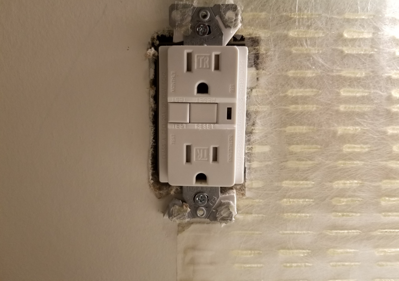 electrical outlet tile installation