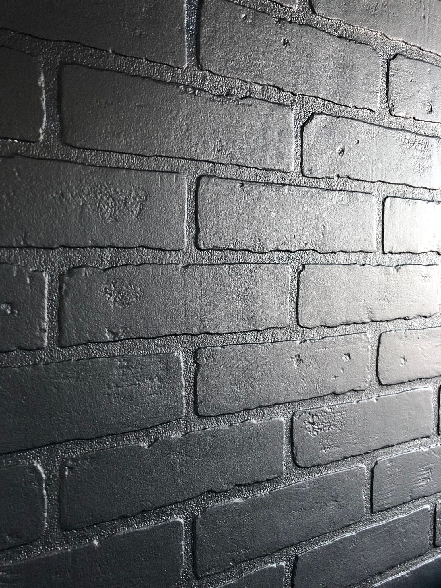 Dark brick accent wall