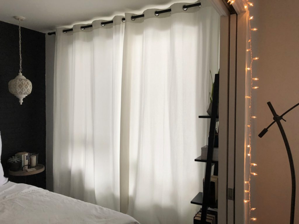 Hang Curtains To Make Your Ceiling